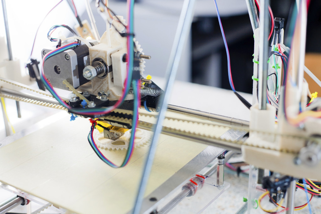 Electronic three dimensional plastic printer during work in scho